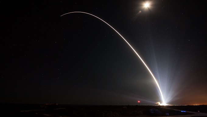 Agreements - at night, a rocket is launched showing it's tail in an arch form