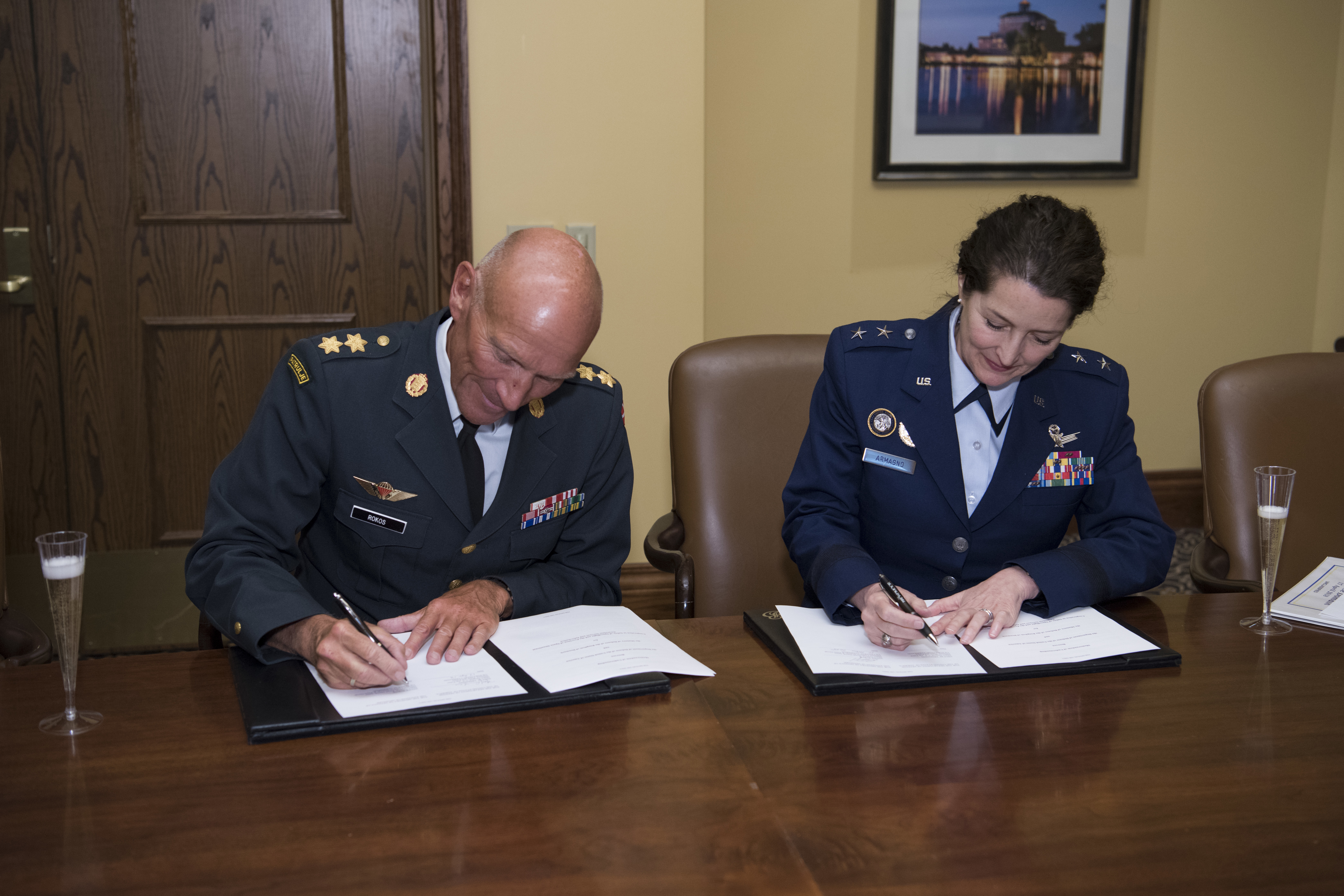 U.S. Air Force Maj. Gen. Nina Armagno (right), U.S. Strategic Command (USSTRATCOM) director of plans and policy, signs a memorandum of understanding at the 34th Annual Space Symposium Apr. 17, 2018, with Maj. Gen. Agner Rokos, representing the Defence Command Denmark and the Ministry of Defence Denmark. The memorandum authorizes sharing space situational awareness services and information with the Defence Command and Ministry of Defence for Denmark. Denmark joins 13 nations (the United Kingdom, the Republic of Korea, France, Canada, Italy, Japan, Israel, Spain, Germany, Australia, the United Arab Emirates, Belgium and Norway), two intergovernmental organizations (the European Space Agency and the European Organization for the Exploitation of Meteorological Satellites) and more than 65 commercial satellite owner/operator/launchers already participating in SSA data-sharing agreements with USSTRATCOM. (U.S. Air Force photo by Dave Grim)