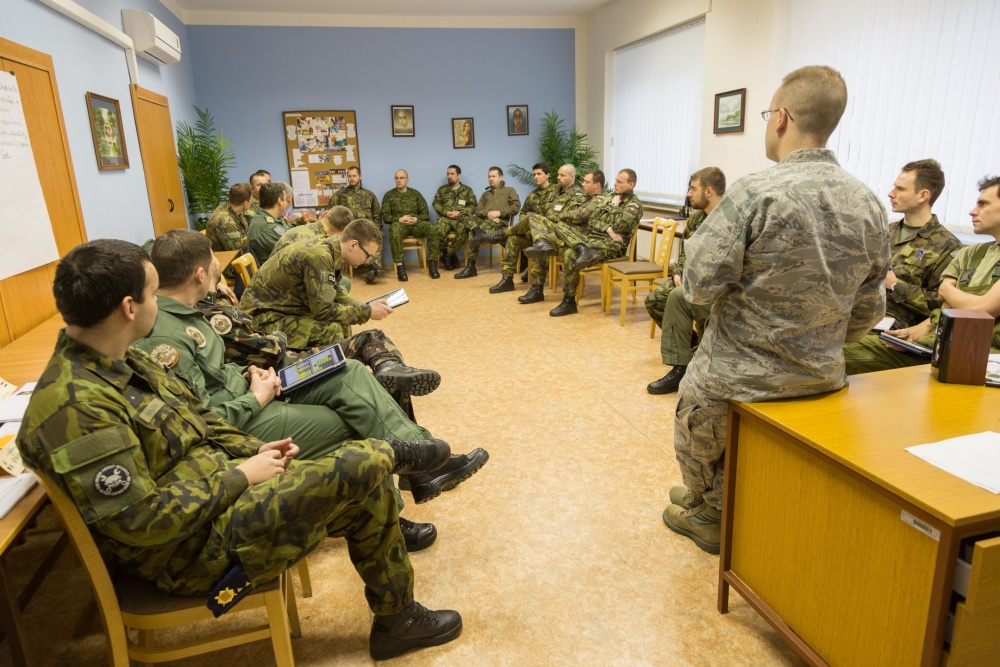 U.S. Air Force Capt. Truett Kinard, a Squadron Officer School instructor from Maxwell Air Force Base, Germany, talks to a class of officers and NCOs during a combined international officer and NCO mobile professional military education course in Brno, Czech Republic. Twenty-one students from Czech Republic, Hungary, Lithuania and Romania participated in the course. This was the Inter-European Air Forces Academy's second two-week course. IEAFA's first five-week in-residence course begins April 25, 2016 at Kapaun Air Station, Germany. (U.S. Air Force photo/Senior Master Sgt. Travis Robbins)
